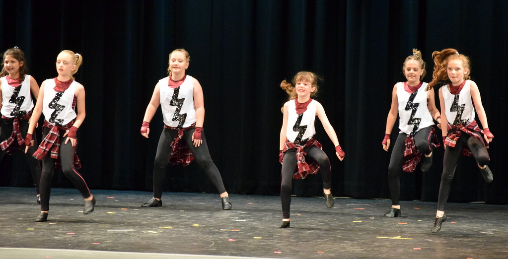 ". Tap dancers perform to ""Pop\"" at Melissa\'s School of Dance and Gymnastics\' \""Dance In Motion\"" recital Wednesday, June 13, 2018. Front row, from left; Emma Henry, Lauren Lorenzo, Aja Richie. Back row, from left; Addison Koester, Lindsey Richie, Abigail Kelley."