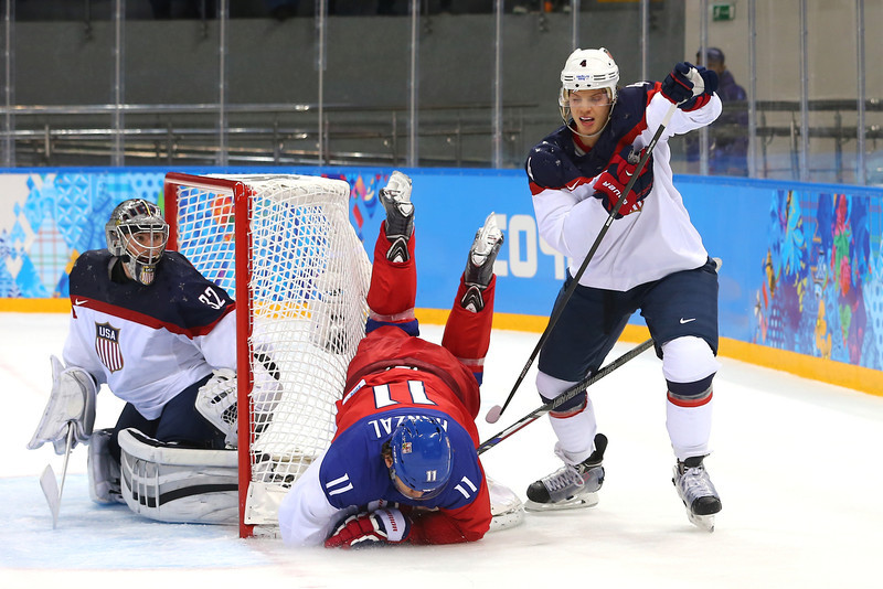 . Martin Hanzal #11 of the Czech Republic falls to the ice against John Carlson #4 of the United States during the Men\'s Ice Hockey Quarterfinal Playoff on Day 12 of the 2014 Sochi Winter Olympics at Shayba Arena on February 19, 2014 in Sochi, Russia.  (Photo by Martin Rose/Getty Images)