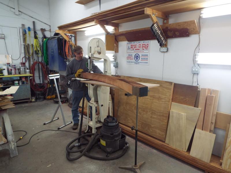 Ruff cutting a new piece of cover board.