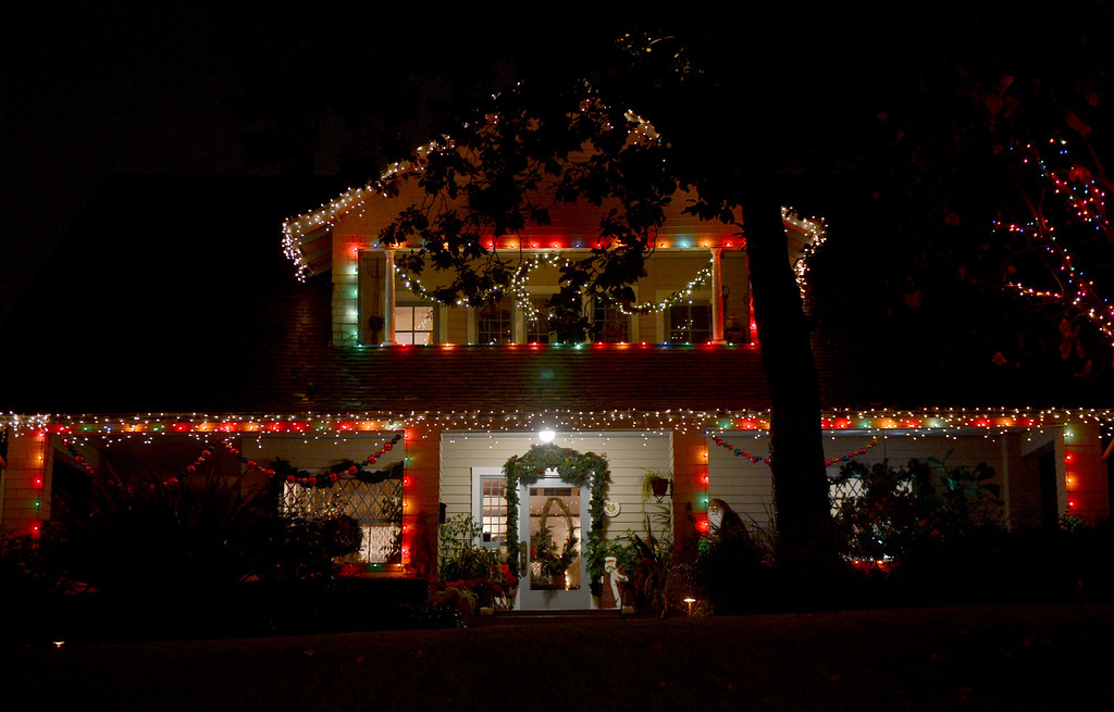. A house is lit up for the holidays on Orange Grove Boulevard Thursday night, December 19, 2013. (Photo by Sarah Reingewirtz/Pasadena Star-News)
