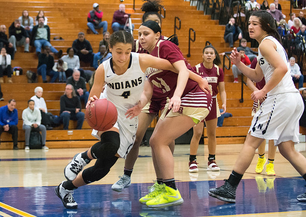 02/13/20 Wesley Bunnell | StaffrrNewington girls basketball defeated New Britain at home Thursday evening. Newington's Alexie Armour (4) dribbles baseline against New Britain's Nataly Hernandez (11).