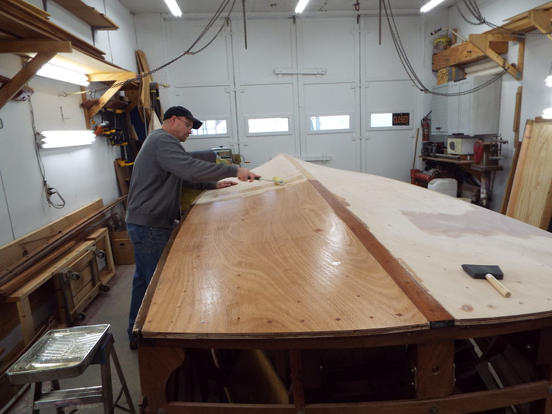 Appling the first of three coats of epoxy to the new bottom.