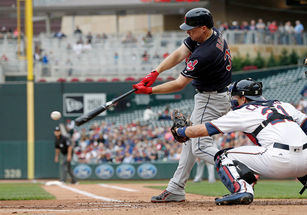 . Cleveland Indians\' Jay Bruce hits a two-run single off Minnesota Twins pitcher Kyle Gibson in the first inning of game one of a double header baseball game Thursday, Aug. 17, 2017, in Minneapolis. (AP Photo/Jim Mone)