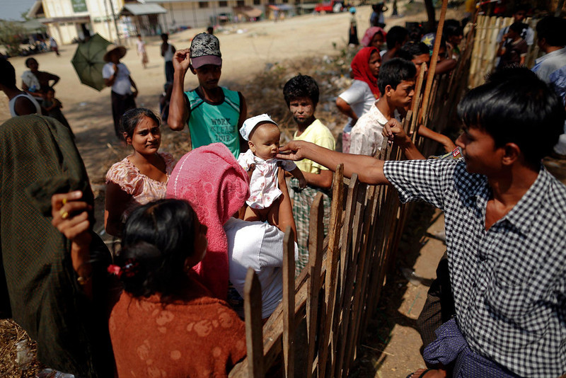 . A baby is lifted over the fence for his uncle to touch his face at a camp for Muslims on Meikhtila\'s outskirts April 25, 2013.  In Myanmar\'s central heartlands, justice and security is elusive for thousands of Muslims who lost their homes in a deadly rampage by Buddhist mobs in March. Many are detained in prison-like camps, unable to return to neighborhoods and businesses razed in four days of violence in Meikhtila that killed at least 43 people, most of them Muslims, displaced nearly 13,000, and touched off a wave of anti-Muslim unrest fueled by radical Buddhist monks. Picture taken April 25, 2013. REUTERS/Damir Sagolj