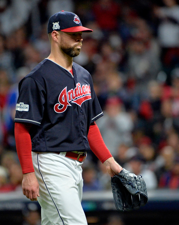 . Cleveland Indians starting pitcher Corey Kluber walks to the dugout in the fourth inning of Game 5 against the New York Yankees in a baseball American League Division Series, Wednesday, Oct. 11, 2017, in Cleveland. Kluber pitched 3 2/3 innings and gave up three hits and three runs. (AP Photo/Phil Long)
