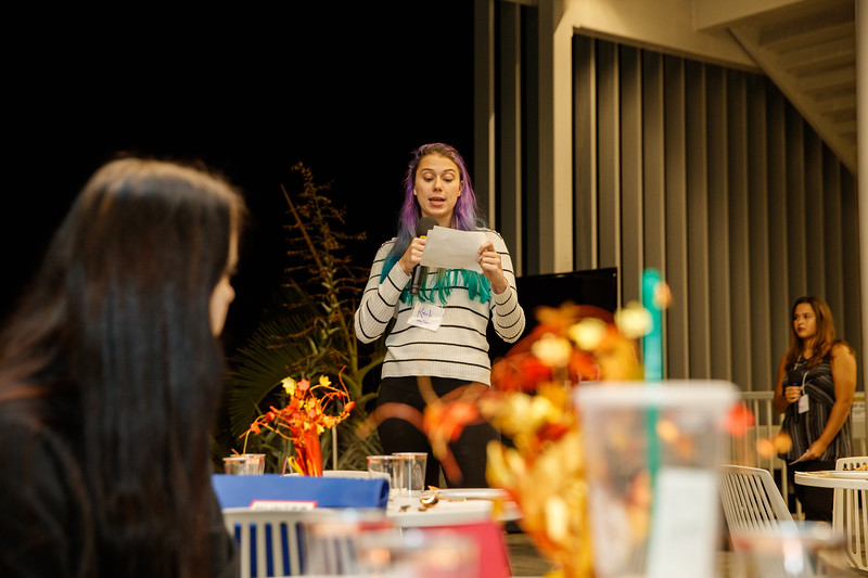 A guest reads her assigned biography at the Oxfam Hunger Banquet at Ringling College of Art and Design Nov. 21.