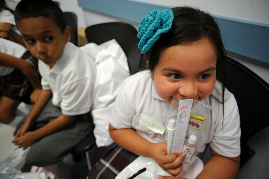 . Joelene Caballero, 7-years-old, waits to have her teeth examined during MEND�s (Meet Each Need with Dignity) 13th annual �Head to Toes,� program at the Pacoima charity�s center Wednesday, August 27, 2014. 240 third-graders from Pacoima�s Vaughn Next Century Learning Center were provided with full back-to-school care: free dental and vision screenings through a healthcare initiative with Verizon Foundation, new shoes and new backpacks chock-full of school supplies school supplies donated by the Ella Fitzgerald Charitable Foundation. (Photo by Hans Gutknecht/Los Angeles Daily News)