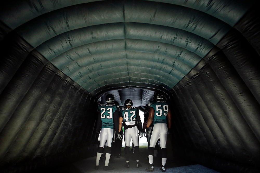 . From left to right, Philadelphia Eagles\' Dominique Rodgers-Cromartie, Kurt Coleman and DeMeco Ryans wait to run onto the field before an NFL football game against the Washington Redskins, Sunday, Dec. 23, 2012, in Philadelphia. (AP Photo/Matt Slocum)
