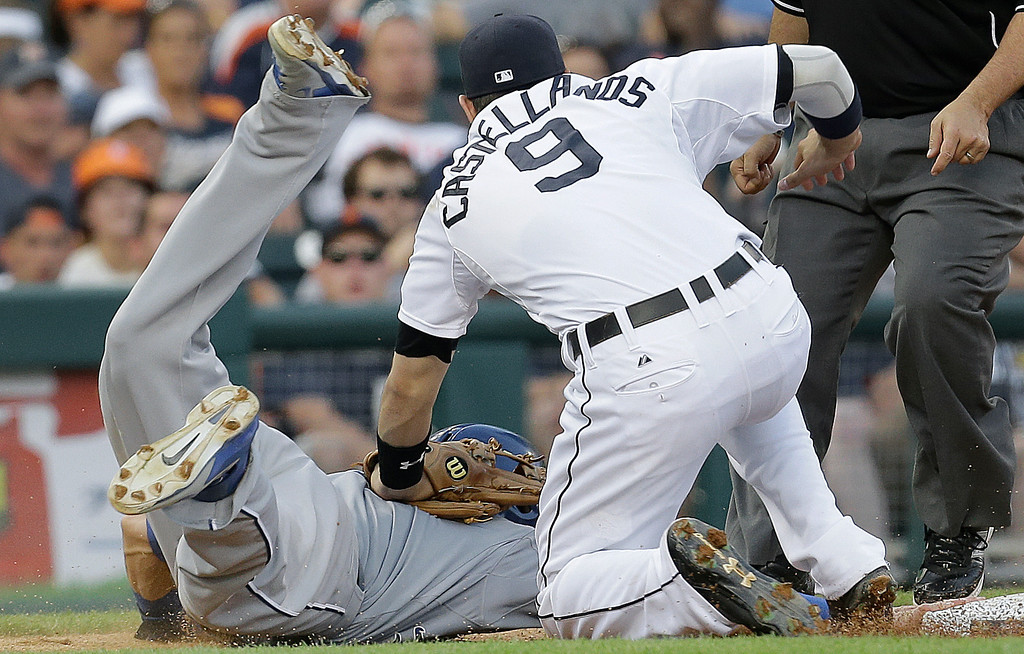 . Detroit Tigers third baseman Nick Castellanos, right, tags Kansas City Royals\' Alex Gordon, left, out at third base on a Alcides Escobar fielders choice in the fifth inning of a baseball game in Detroit, Tuesday, June 17, 2014.  (AP Photo/Paul Sancya)