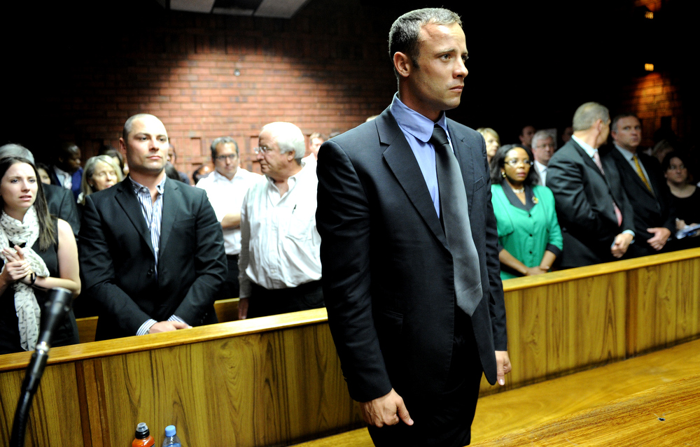 Description of . South African Olympic sprinter Oscar Pistorius (C) appears on February 19, 2013 at the Magistrate Court in Pretoria as he father Henke (3rd L), brother Carl (2nd L) and sister Aimee (L) attend. Pistorius battled to secure bail as he appeared on charges of murdering his model girlfriend Reeva Steenkamp on February 14, Valentine's Day. South African prosecutors will argue that Pistorius is guilty of premeditated murder in Steenkamp's death, a charge which could carry a life sentence.  STEPHANE DE SAKUTIN/AFP/Getty Images