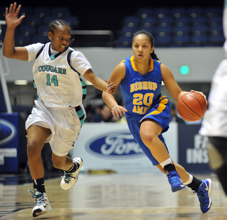 . Bishop Amat\'s Janae Chamois (#20) drive the ball down as they play Canyon Springs in the CIF-SS Division 1A girls basketball finals at the Anaheim Arena on Friday March1, 2013. Canyon Springs beat Bishop Amat 48-46. (SGVN/Staff Photo by Keith Durflinger)