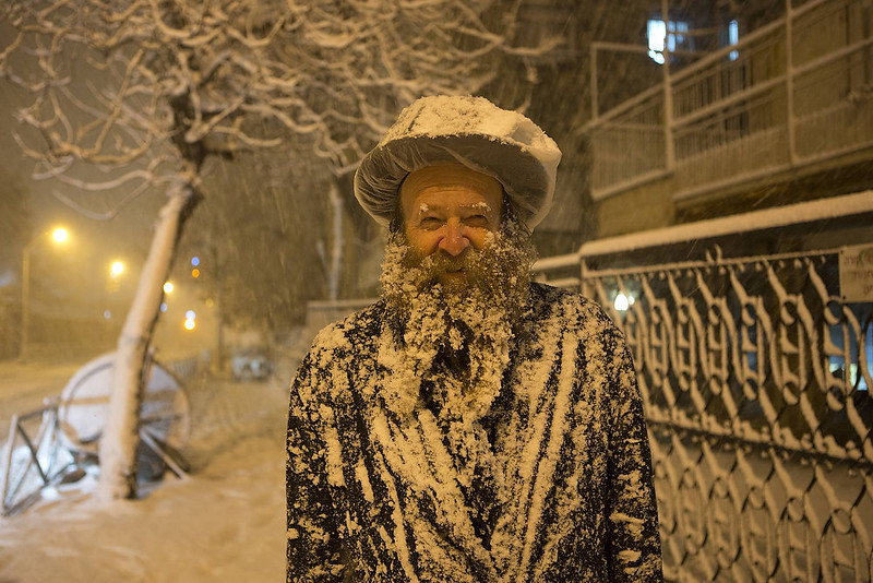 . An Ultra-Orthodox Jewish man covered with snow walks in Jerusalem on January 10, 2013. Jerusalem was transformed into a winter wonderland after heavy overnight snowfall turned the Holy City and much of the region white, bringing hordes of excited children onto the streets. MENAHEM KAHANA/AFP/Getty Images
