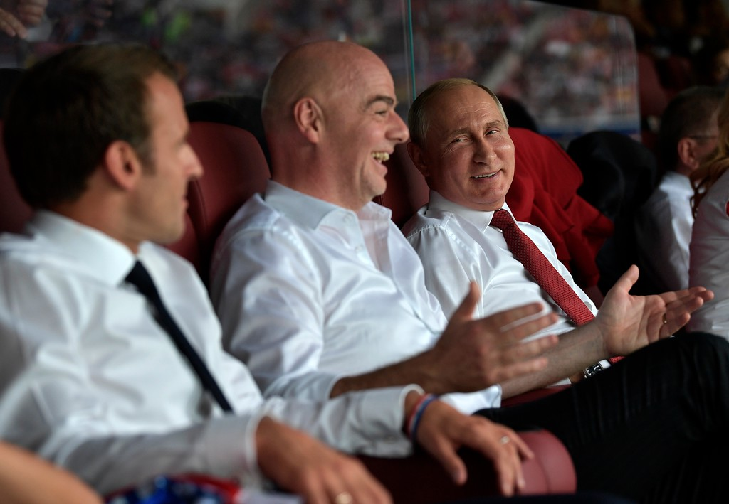 . French President Emmanuel Macron, left, FIFA President Gianni Infantino, center, and Russian President Vladimir Putin react during the final match between France and Croatia at the 2018 soccer World Cup in the Luzhniki Stadium in Moscow, Russia, Sunday, July 15, 2018. (Alexei Nikolsky, Sputnik, Kremlin Pool Photo via AP)
