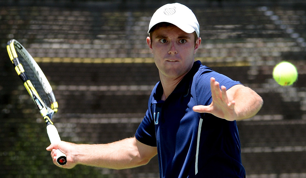 . University\'s (Irvine) Drew Dawson returns a shot by San Marino\'s Daniel Gealer (not pictured) during the CIF State Tennis Championship at the Claremont Club in Claremont, Calif., on Saturday, May 31, 2014. Gealer won 7-6, 6-1.   (Keith Birmingham/Pasadena Star-News)