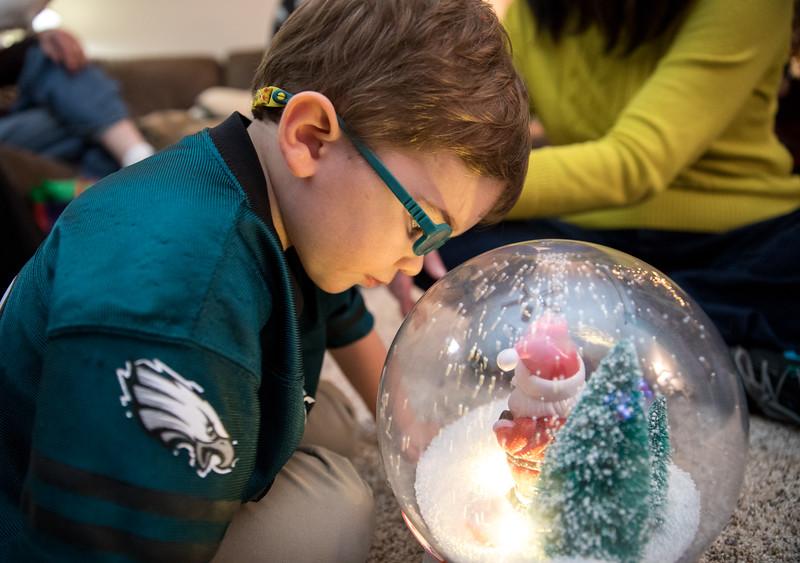 Caleb Looking in Snow Globe Close.jpg
