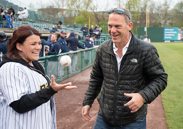 05/03/19 Wesley Bunnell | Staff The New Britain Bees home opener vs the Somerset Patriots on Friday night at New Britain Stadium. New Britain Mayor Erin Stewart tosses a ball in the air while standing next to Bees partner Anthony Iacovone before throwing out her ceremonial first pitch.