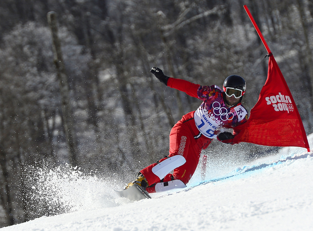 . Switzerland\'s Philipp Schoch competes in the Men\'s Snowboard Parallel Giant Slalom 1/8 Finals at the Rosa Khutor Extreme Park during the Sochi Winter Olympics on February 19, 2014.  JAVIER SORIANO/AFP/Getty Images