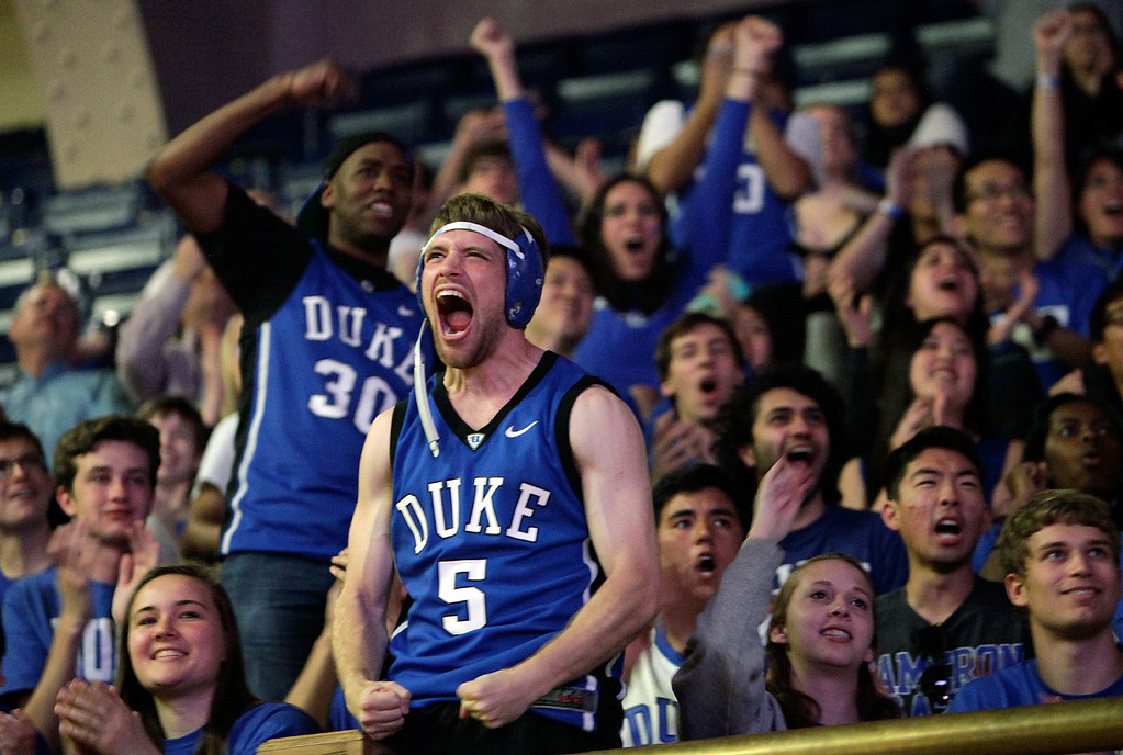 . Duke sophomore Jack Grady celebrates after watching a broadcast at Cameron Indoor Stadium, in Durham, N.C., of the NCAA Final Four college basketball game between Duke and Michigan State, Saturday, April 4, 2015. Duke won 81-61. (AP Photo/The Herald-Sun, Christine T. Nguyen)