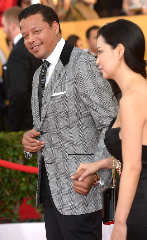 . Terrence Howard and guest arrives at the 20th Annual Screen Actors Guild Awards  at the Shrine Auditorium in Los Angeles, California on Saturday January 18, 2014 (Photo by Michael Owen Baker / Los Angeles Daily News)