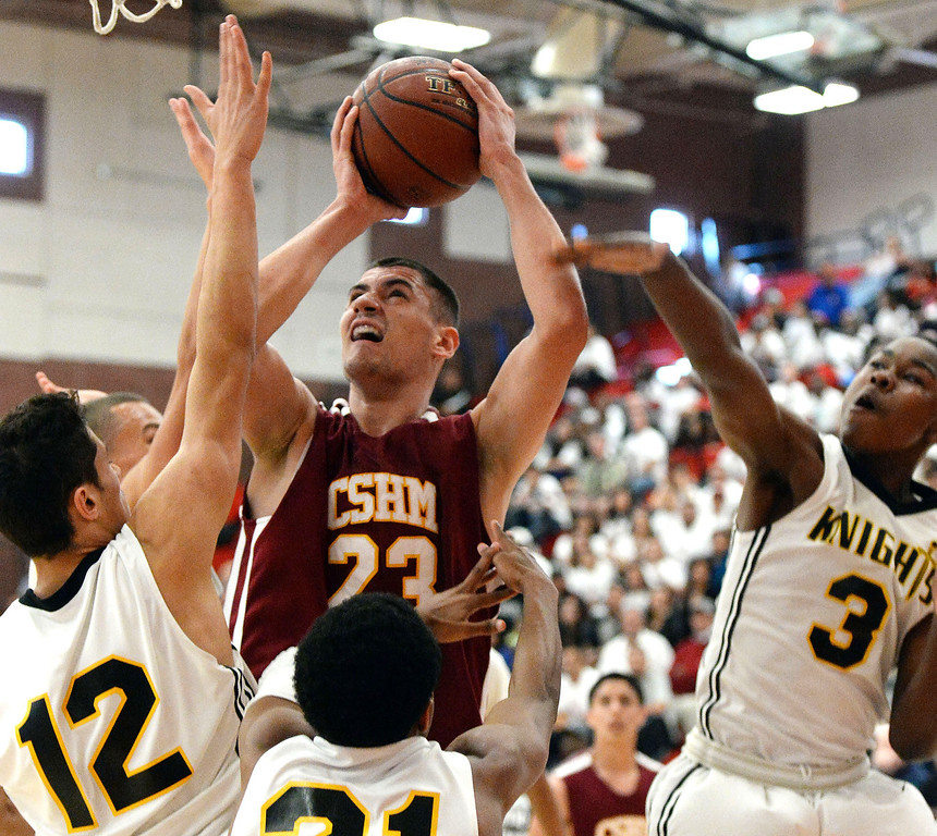 . Cantwell\'s Gligorije Rakocevic (23) drives to the basket against Bishop Montgomery in the first half of a CIF Southern California Regional Division IV basketball game at Colony High School in Ontario, Calif., on Saturday, March 22, 2014.  (Keith Birmingham Pasadena Star-News)