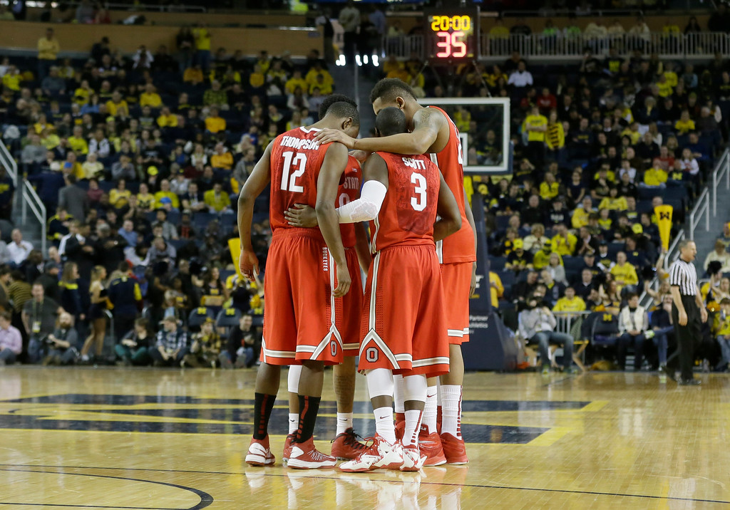 . The Ohio State starters meet at half court before during the second half of an NCAA college basketball game against Michigan, Sunday, Feb. 22, 2015 in Ann Arbor, Mich. Michigan defeated Ohio State 64-57. (AP Photo/Carlos Osorio)