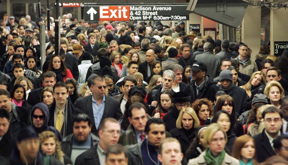 Description of . Commuters pass through Grand Central Terminal during morning rush hour December 19, 2005 in New York City.  (Photo by Mario Tama/Getty Images)