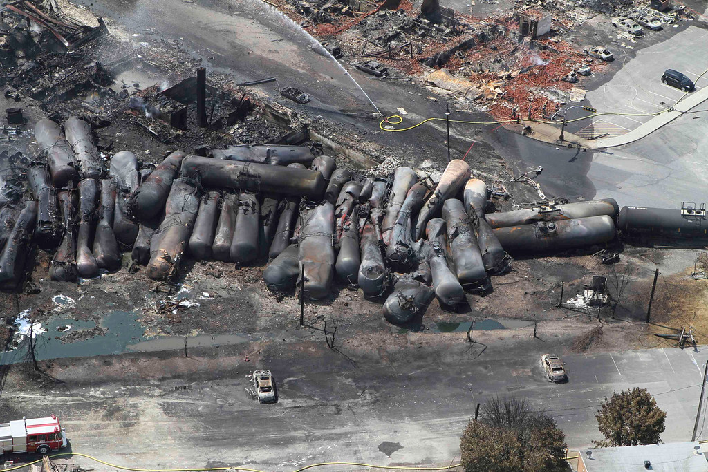 . An aerial view of burnt train cars after a train derailment and explosion in Lac-Megantic, Quebec July 8, 2013, in this picture provided by the Transportation Safety Board of Canada.  REUTERS/Transportation Safety Board of Canada/Handout via Reuters