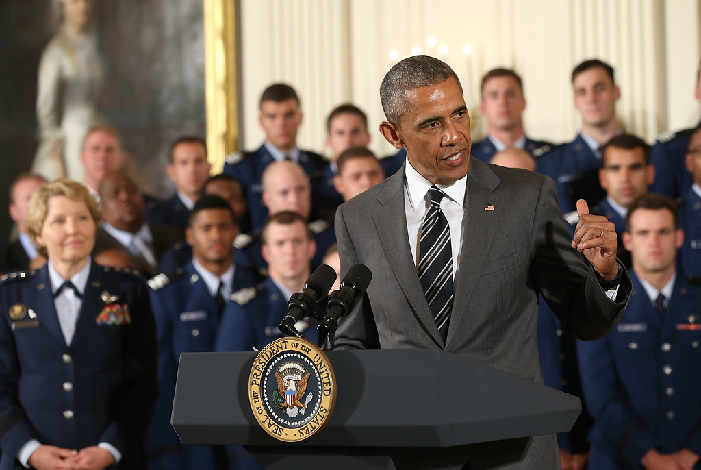 . President Barack Obama speaks during the Commander-in-Chief trophy presentation to the United States Air Force Academy football team in the East Room of the White House May 7, 2015 in Washington, DC. The Commander-in-Chief trophy is awarded each year to the winner of the American football series featuring the U.S. Naval Academy, U.S. Air Force Academy and U.S. Military Academy. (Photo by Win McNamee/Getty Images)