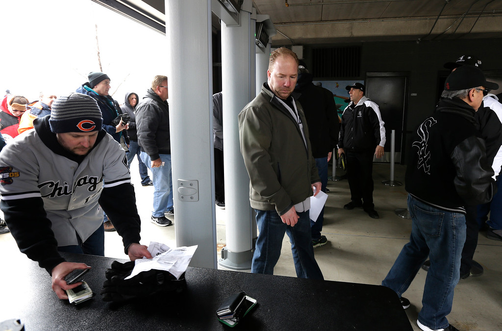 . Baseball fans check at a security checkpoint before an opening day baseball game between the Cleveland Indians and the Chicago White Sox Friday, April 8, 2016, in Chicago. (AP Photo/Nam Y. Huh)