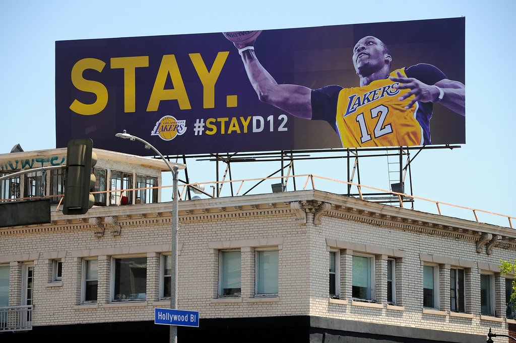 . The Lakers have put up a billboard on Hollywood Boulevard and Las Palmas Avenue asking Dwight Howard to stay, Thursday, June 27, 2013. (Michael Owen Baker/L.A. Daily News)