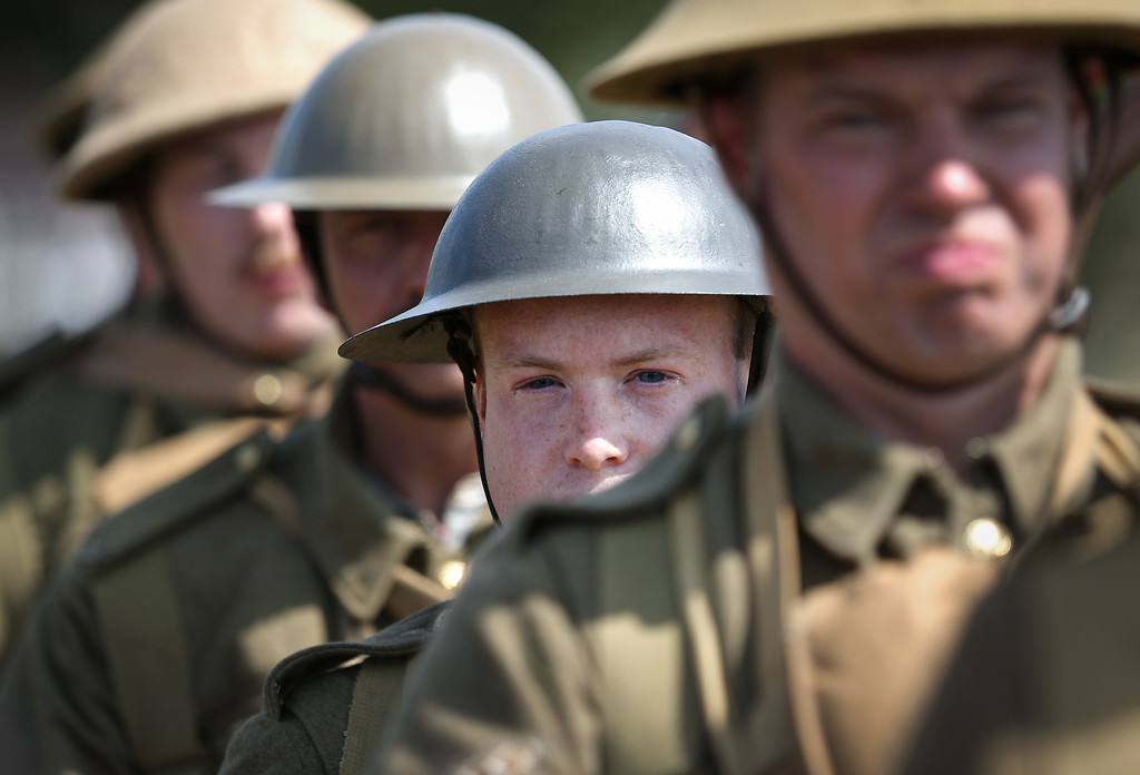 . BOVINGTON, UNITED KINGDOM - AUGUST 04:  Members of the Great War Society living history group dressed as 4th Battalion the Middlesex Regiment wait to take part in a World War One centenary ceremony at the Tank Museum, Bovington on August 4, 2014 in England. Monday August 4, 2014  marks the 100th anniversary of Great Britain\'s declaration of war on Germany. In 1914 British Prime Minister Herbert Asquith announced at 11 pm that Britain was to enter the war after Germany had violated Belgium neutrality. The First World War or the Great War lasted until 11 November 1918 and is recognised as one of the deadliest historical conflicts with millions of causalities. A series of events commemorating the 100th anniversary are taking place throughout the day.  (Photo by Peter Macdiarmid/Getty Images)