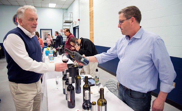 02/27/20 Wesley Bunnell | StaffrrA wine tasting was held on Thursday night with proceeds benefiting Wreaths Across America was held at the New Britain VFW Post. Pierre Hill samples a wine selection at the Allan S. Goodman table which was staffed by Michael Greenberg.