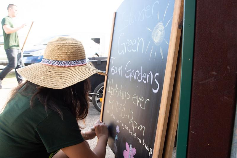 Devika Tijerina updates the Islander Green Team's board.