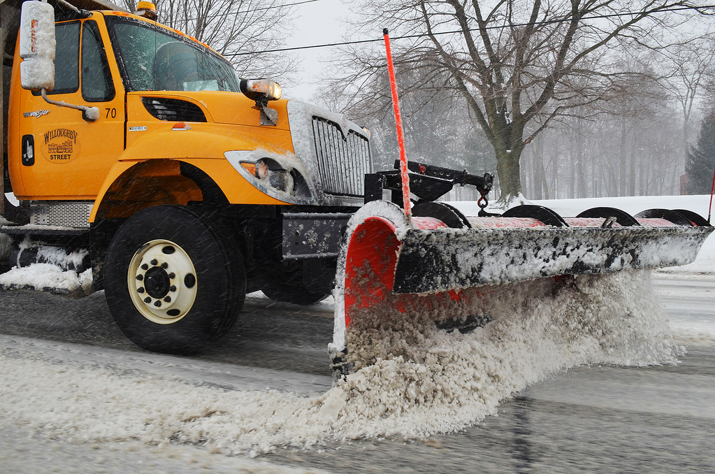 . Michael Allen Blair/MBlair@News-Herald.com A plow truck from the City of Willoughby clears snow along Route 20 during Wednesday\'s winter storm.