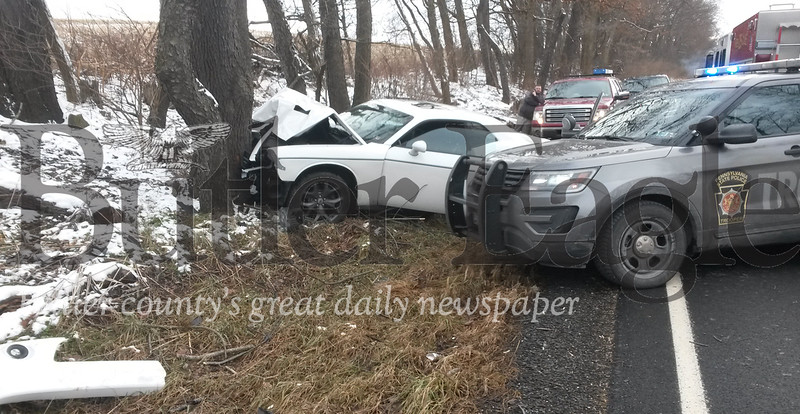 The male driver of this car suffered minor injuries after losing control of the vehicle and hitting a tree on Route 308 in Clay Township Wednesday afternoon.