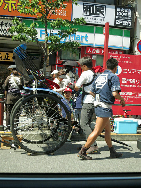 """Back on Kaminarimon. The rickshaw driver (puller?) has strong legs and good shoes. """"Rickshaw"""" means """"human-powered vehicle."""""""