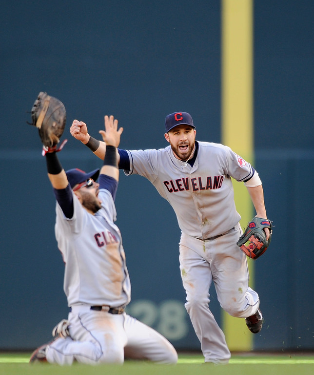 . MINNEAPOLIS, MN - SEPTEMBER 29: Jason Kipnis #22 and Nick Swisher #33 of the Cleveland Indians celebrates a win of the game against the Minnesota Twins on September 29, 2013 at Target Field in Minneapolis, Minnesota. The Indians defeated the Twins 5-1 and clinched a American League Wild Card berth. (Photo by Hannah Foslien/Getty Images)