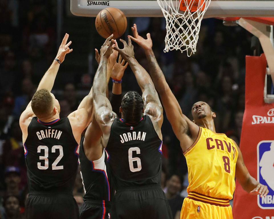 . Cleveland Cavaliers\' Channing Frye, right, fights for a rebound with Los Angeles Clippers\' Blake Griffin and DeAndre Jordan during the first half of an NBA basketball game Saturday, March 18, 2017, in Los Angeles. (AP Photo/Jae C. Hong)