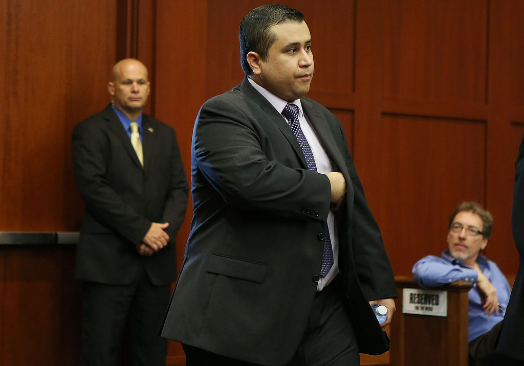 . George Zimmerman enters the courtroom for his trial before the jury continued their deliberations in Seminole circuit court in Sanford, Fla. Saturday, July 13, 2013. Zimmerman has been charged in the 2012 shooting death of Trayvon Martin. (AP Photo/Orlando Sentinel, Gary W. Green, Pool)