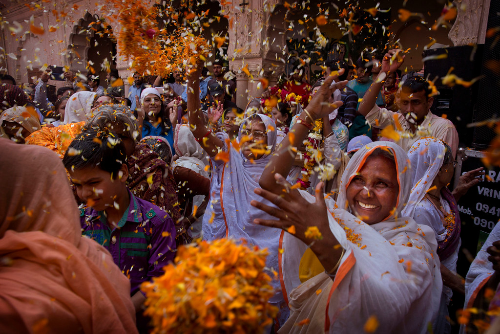 . Hindu widows, who were once forbidden to participate, throw flower petals and colored powder during the religious arrival of spring festival called Holi at the Gopinath temple in Vrindavan, 180 kilometers (112 miles) south-east of New Delhi, India, Thursday, March 9, 2017. Up to just a few years ago the festival was forbidden for Hindu widows. Like hundreds of thousands of observant Hindu women, they would have been expected to live out their days in quiet worship, dressed only in white, with their very presence being considered inauspicious for all religious festivities. (AP Photo /Manish Swarup)