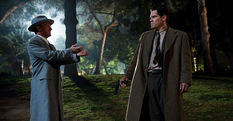 ". This film image released by Warner Bros. Pictures shows Sean Penn, left, as Mickey Cohen and Josh Brolin, as Sgt. John O\'Mara in ""Gangster Squad.\"" (AP Photo/Warner Bros. Pictures, Wilson Webb)"