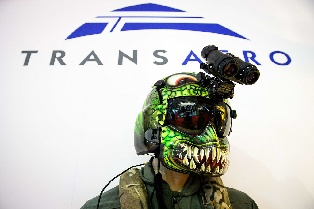. Military helmets are displayed on the Transaero stand at the Farnborough air show in Hampshire, England, on July 14, 2014. The biennial event sees leading companies from the aviation industry showcase their latest technology. AFP PHOTO / LEON  NEAL/AFP/Getty Images