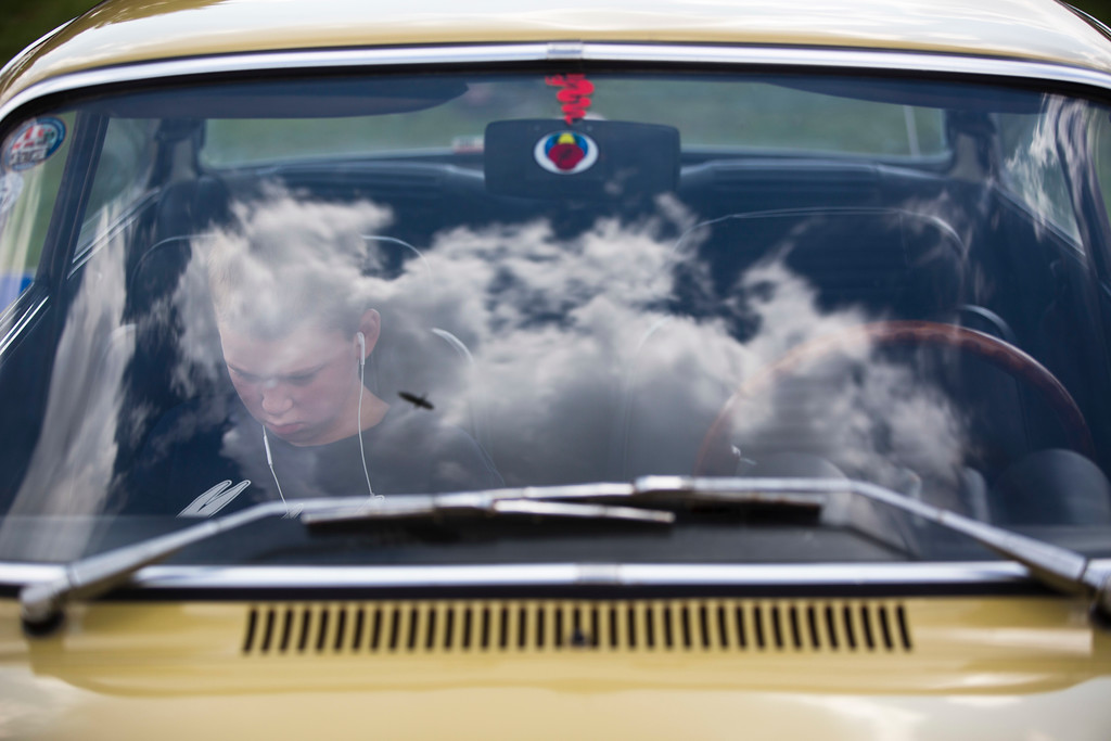 ". A youth sits in his grandfather antique car during the 31st annual ""Five Club\"" car collectors\' meeting in Ramat Gan, Israel, Friday, Oct. 6, 2017. Each weekend, at Israeli gas stations and parking lots and parks, car collectors gather with their beauties _ and take a step back in time. (AP Photo/Oded Balilty)"