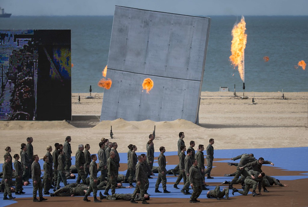 . Actors perform during an international D-Day commemoration ceremony on the beach of Ouistreham, Normandy, on June 6, 2014, marking the 70th anniversary of the World War II Allied landings in Normandy.  AFP PHOTO / POOL / IAN LANGSDON/AFP/Getty Images
