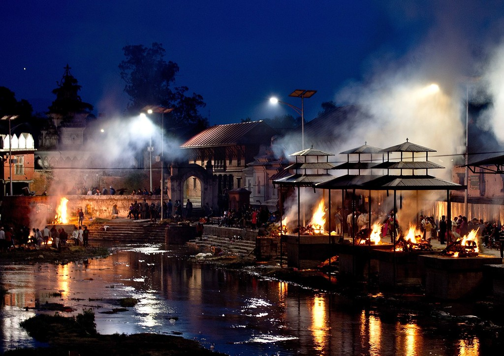 . Funeral pyres burn during a mass cremation of earthquake victims on the banks of Bagmati river at the Pasupathinath temple in Kathmandu on April 29, 2015.  The United Nations appealed for $415 million for Nepal, saying it urgently needs more funds to provide relief to people affected by a devastating earthquake.      AFP PHOTO / MANAN  VATSYAYANA/AFP/Getty Images