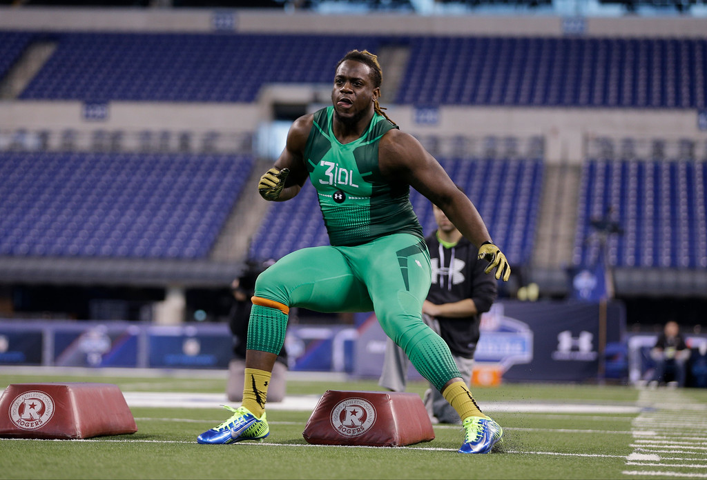. Clemson defensive lineman Tavaris Barnes runs a drill at the NFL football scouting combine in Indianapolis, Sunday, Feb. 22, 2015. (AP Photo/David J. Phillip)