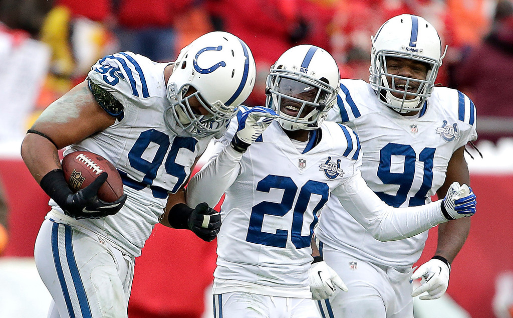 . Indianapolis Colts defensive end Fili Moala (95) celebtates with teammates Darius Butler (20) and Ricardo Mathews (91) after Moala recovered a fumble during the second half of an NFL football game against the Kansas City Chiefs Sunday, Dec. 22, 2013, in Kansas City, Mo. The Colts won 23-7. (AP Photo/Charlie Riedel)