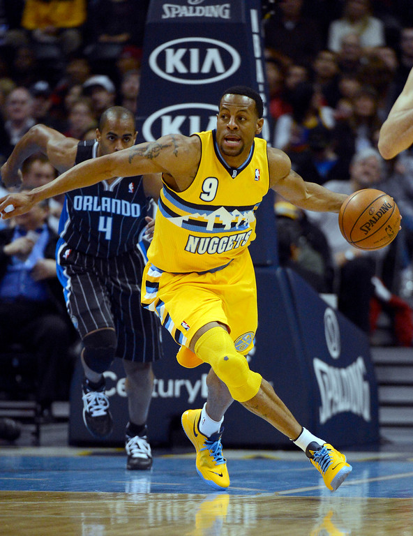 . Denver Nuggets shooting guard Andre Iguodala (9) pushes the ball up the court during the first quarter against Orlando Magic Wednesday, January 9, 2013 at Pepsi Center. John Leyba, The Denver Post
