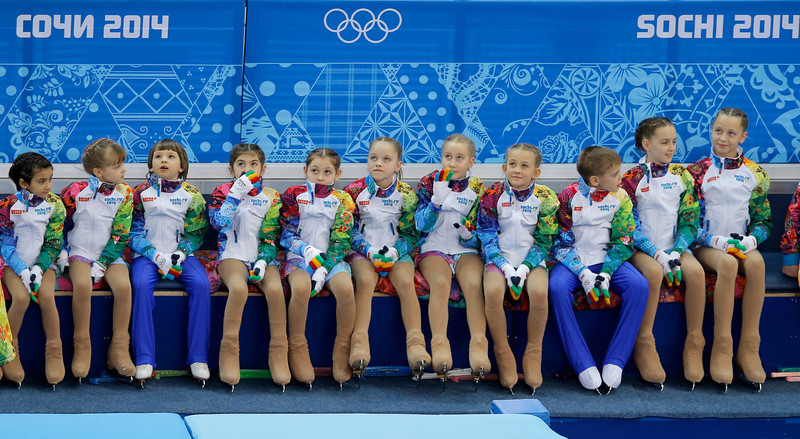 . Children wait to skate prior to the start of the men\'s team short program figure skating competition at the Iceberg Skating Palace during the 2014 Winter Olympics, Thursday, Feb. 6, 2014, in Sochi, Russia. (AP Photo/Vadim Ghirda)