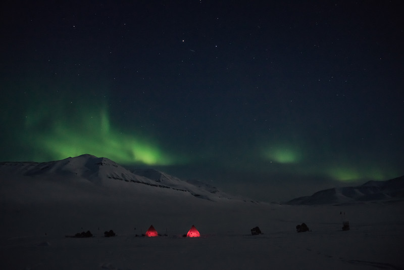 Field camp under the Aurora, Pingeldal, North-East Greenland